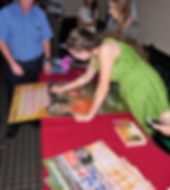 Quinn Alexis signing a REMEMBER THE GOAL movie poster at the premiere