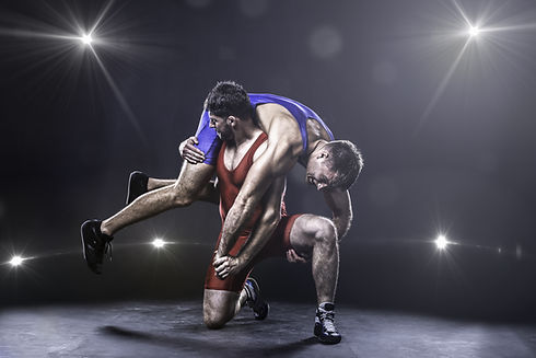 Two freestyle wrestlers in red and blue