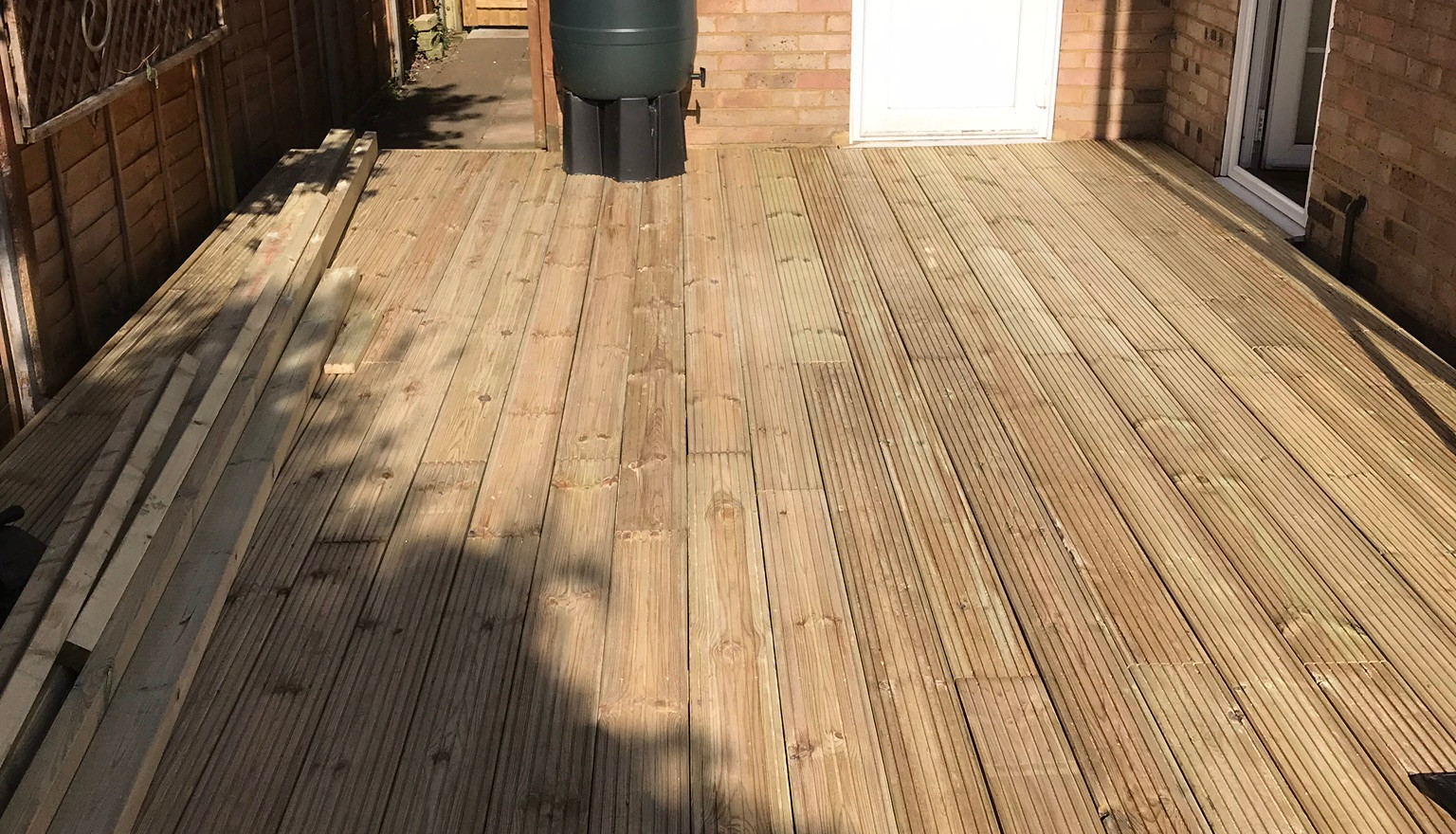 New deck boards down and sweeping up