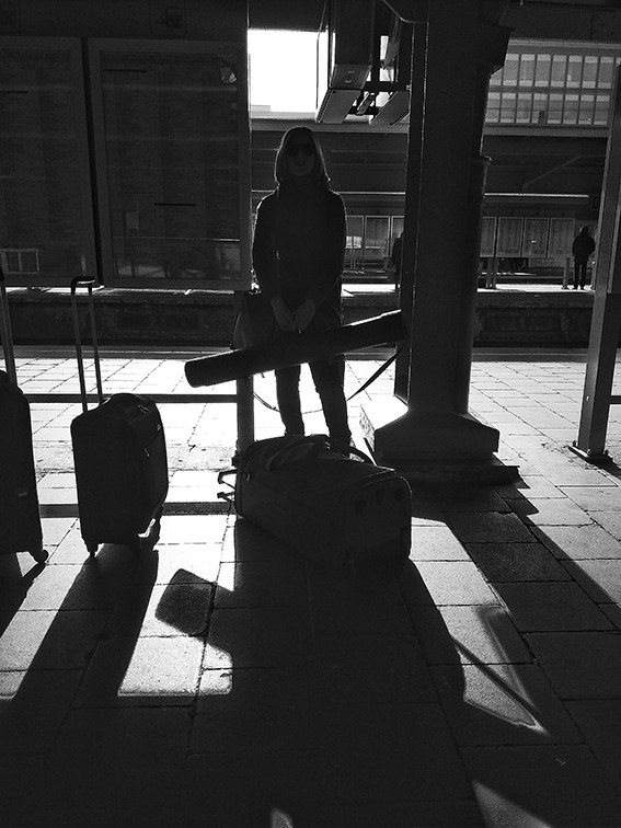 Waiting for the airport train at Gare du Midi. The morning sun was very strong and created a powerful shadow.