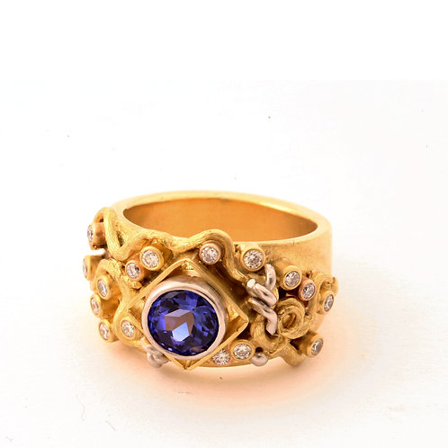 1.78 Carat Tanzanite with .43 ctw G-H color, VS2 clarity Diamonds in 18k Gold an
