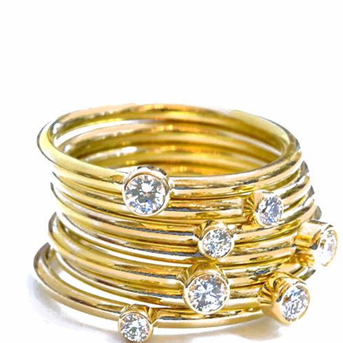 Diamond Stacking Rings in 18k Gold.