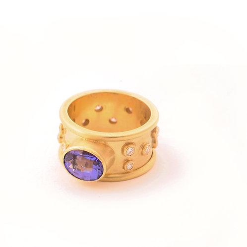 2.35 Carat Tanzanite with .44 ctw G-H color, VS2 clarity Diamonds in 18k Gold