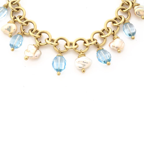 18k Charm Bracelet with Freshwater Pearls and Blue Topaz with Toggle Clasp.