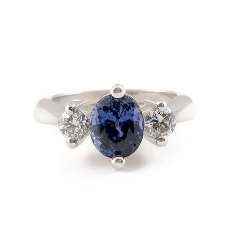 3.36 ct Oval Cut Blue Sapphire with .59 ctw Diamond Sidestones set in Platinum.