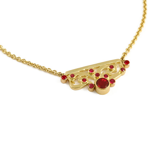 Ruby and pierced 18k plaque on chain.