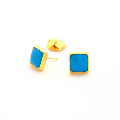 Turquoise Cabochons set in 18k Gold Bezels.