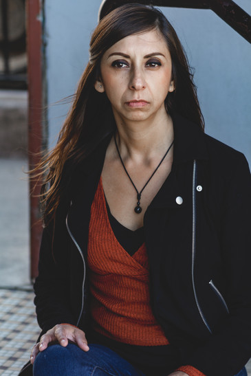 Cindy loves live music, so Alex took her to the infamous Orange Peel venue to make her feel at home. With harsh lighting as a challenge, the pair pulled through with some simple matte shots.
