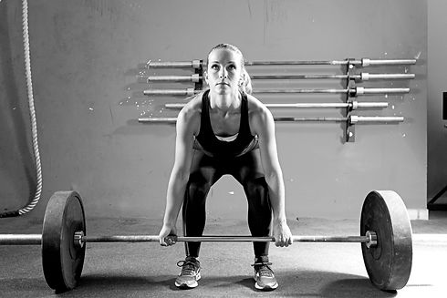 Young Woman On A Weightlifting Session -