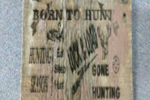Wood signs born to hunt