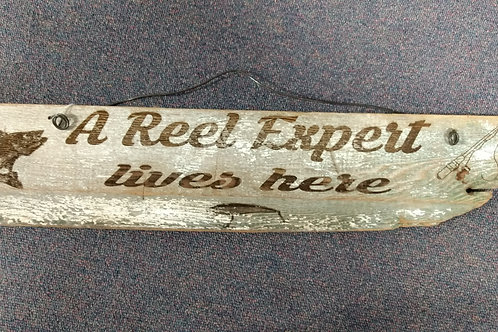 A Reel Expert live here sign