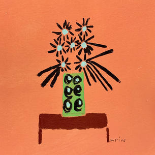Green vase on straight legs.