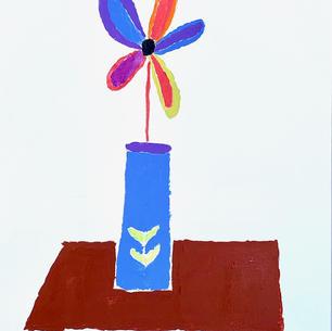 Single Flower on Brown table.