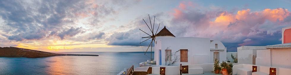 sunset-oia-village-santorini-island-gree