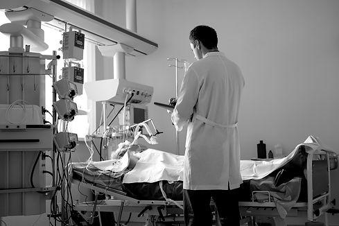intensive-care-caucasian-doctor-examines