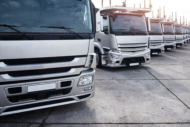 group-trucks-parked-row.jpg