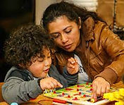 Mom and son playing a board game