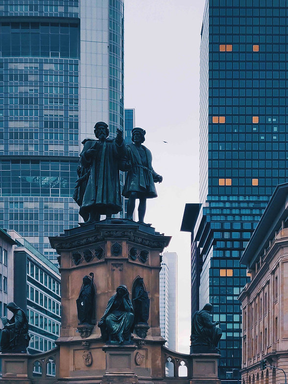 photo-of-monument-near-buildings-2467210