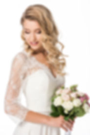 curly young bride with bouquet isolated