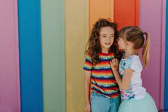 Girlfriends whispering, Powerful Kids