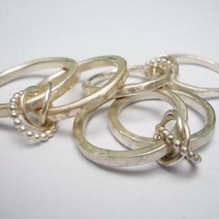 Three Eternity Knot Rings