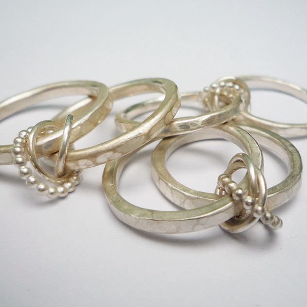 Three Eternity Knot Rings