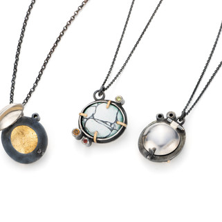 Reverse of Butters Tor Locket Necklaces