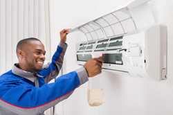 Canva - Technician Cleaning Air Conditio