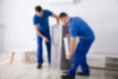 Canva - Two Male Movers Packing Furnitur