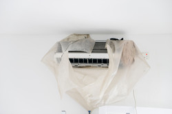 Canva - Dirty Air Conditioner Wrapped by