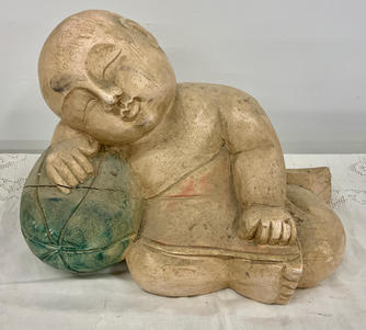 Carved statue of child