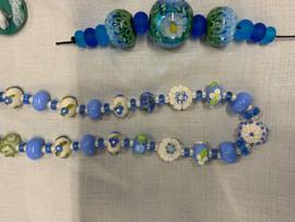Lampwork beads in blue.jpeg