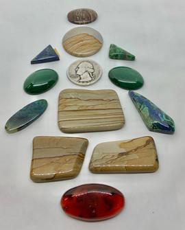 lot of polished stones cabochons.jpeg