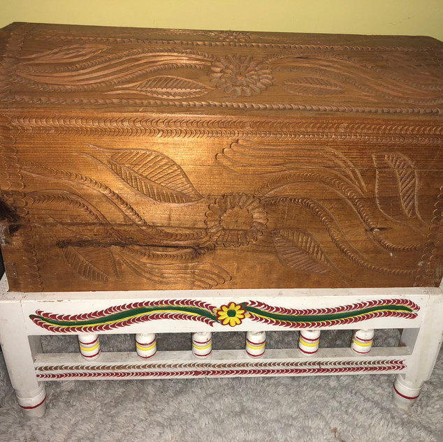 Hand carved chest on stand.