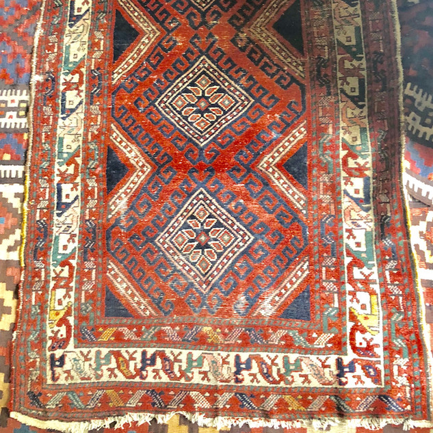 One of many small rugs in this auciton