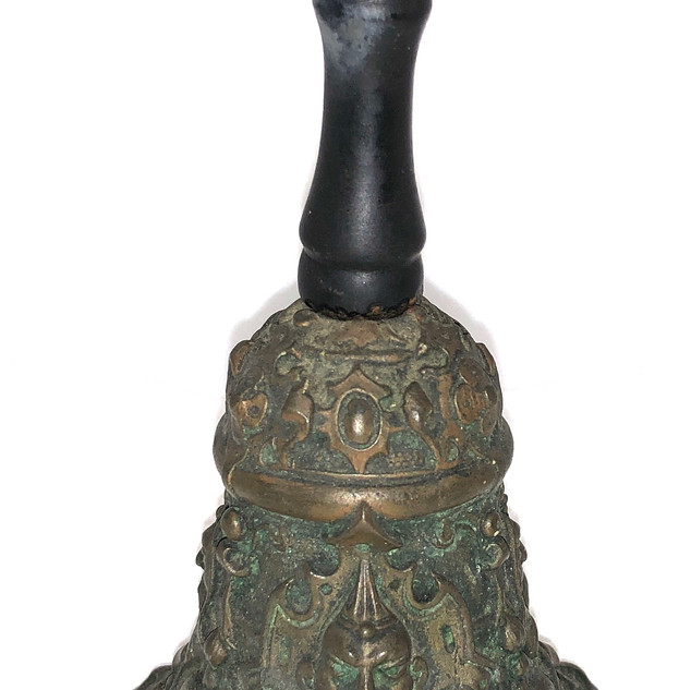 antique bell with green man.jpeg
