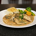 Chicken Piccata with mushrooms, capers and a garlic cream sauce