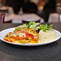 Vegetarian Napoléon – polenta cakes with zucchini, squash, red peppers, portabella mushrooms, mozzarella over marinara sauce with mixed greens salad