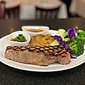 10oz. Angus Beef New York Strip Steak with a cabernet reduction sauce