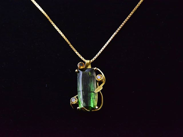 green tourmaline in 18k gold, citrine accents