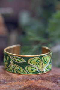 Silver and gold hand-embroidered Zari work embellish this brass cuff bracelet.