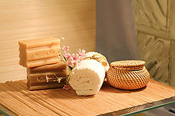 spa soap, towel and basket