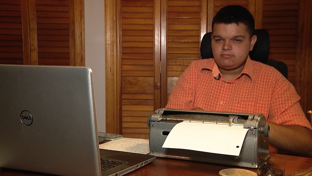 Trent Ferguson typing on brailler.