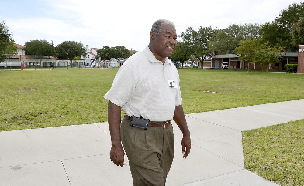 Hank White walking on FSDB campus.