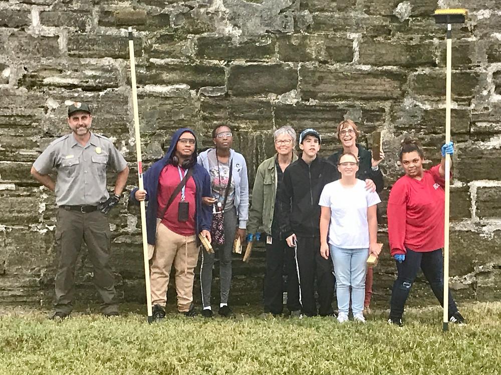 FSDB Blind High School Outdoor Club members standing in front of the Castillo de San Marcos.