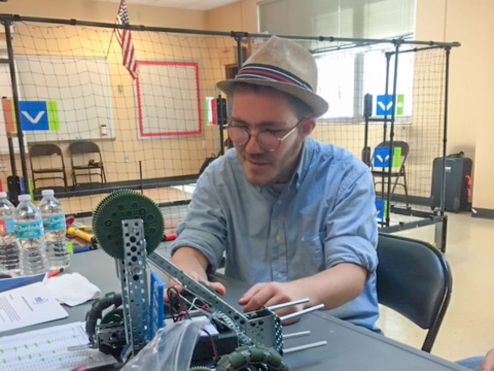FSDB student Chris Weber works on a robot.