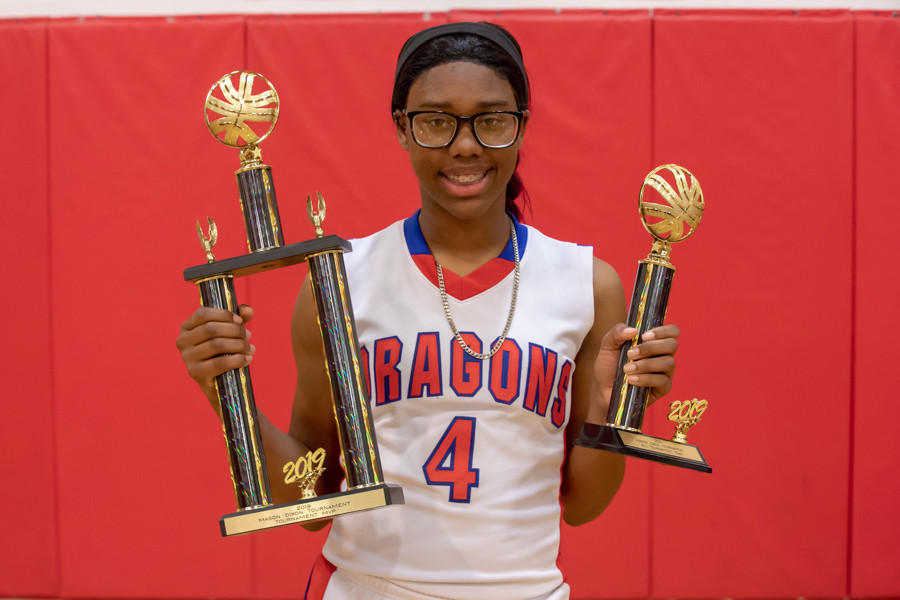 Olivia Brown holding the MVP trophy from the Mason-Dixon Tournament.