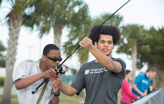 FSDB Deaf student helping blind student fish during the recreation program