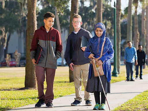 Three FSDB blind students walk down Palm Row