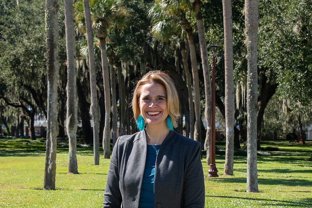 FSDB President Tracie C. Snow standing in Palm Row